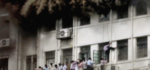 people escaping fire in building